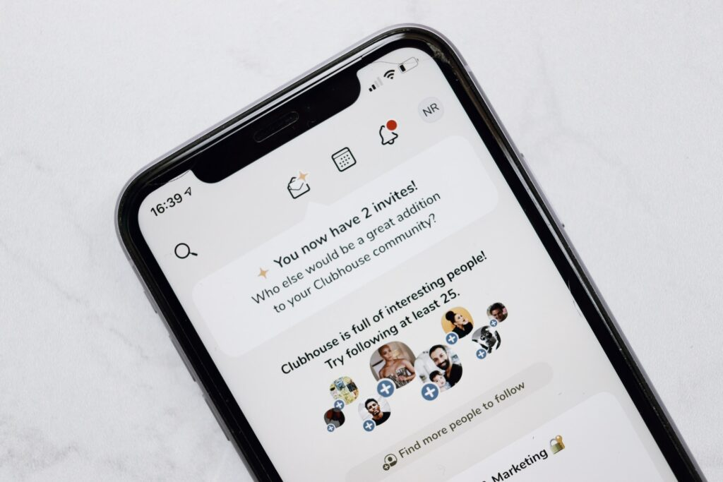 a phone displaying the clubhouse social app